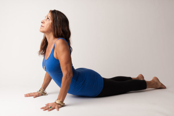 Maria wearing blue in Cobra Bhujangasana
